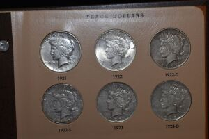 Silver, Wedding Ring & Coins; Morgans, Peace, Silver Eagles & Silver Rounds at Absolute Online Auction