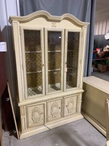 CHINA CABINET WITH DISPLAY LIGHT AND BRASS CROSSHATCHING ON FRONT GLASS PANELS