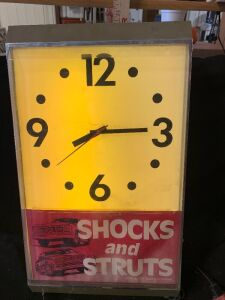SHOCKS AND STRUTS LIGHT UP CLOCK